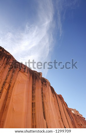 An abstract view of a towering sandstone cliff in the desert of the American southwest. - stock photo