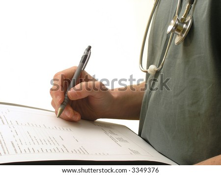 An accident and emergency department Doctor in Medical scrubs with patient admittance forms. - stock photo