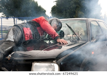 An accident between a motorcycle and a car - stock photo