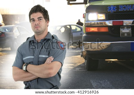 An accident scene on the road of a city with ambulance and fire fighter. - stock photo