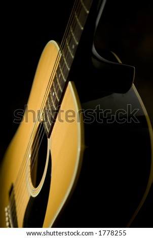 An acoustic Guitar sitting in a warm light - stock photo