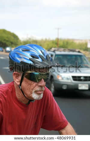 an active retired senior citizen enjoys outdoor activities like bike riding