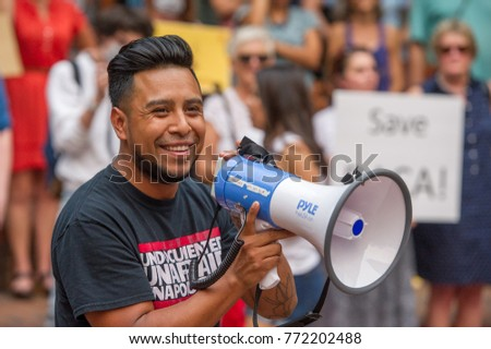 "An activist wearing a t-shirt reading ""Undocumented and Unafraid"" speaks at a rally to protest president Donald Trump's decision to end DACA Downtown Portland, Oregon, on September 5th, 2017."