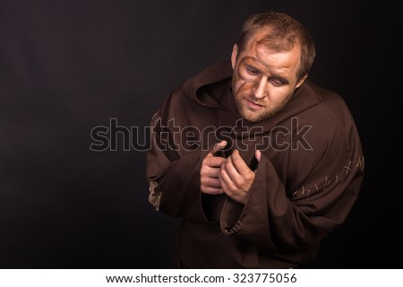 An actor in the guise of a beggar. Professional acting on camera. A scene from a theatrical production. Photo for theater signage and posters. The classic image of a beggar.  - stock photo