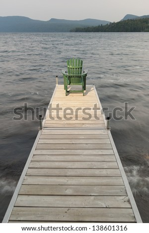An adirondack chair on a dock at Lake Willoughby Vermont, USA - stock photo