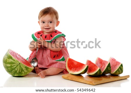 An adorable baby girl happily preparing ti dig into a watermelon.  Isolated on white. - stock photo