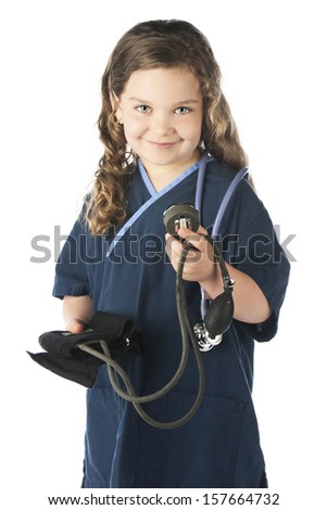 """An adorable elementary """"nurse"""" preparing to take a patient's blood pressure.  On a white background. - stock photo"""