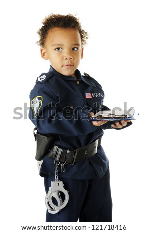 An adorable preschool police officer prepared to write a ticket to an offender.  On a white background. - stock photo