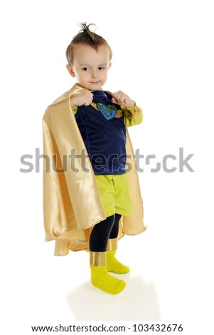 An adorable preschool superhero flexing his muscles under his cape.  On a white background. - stock photo