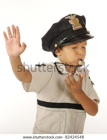 "An adorable preschooler gesturing ""stop,"" while wearing the police hat and blowing a whistle.  Isolated. - stock photo"