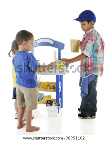 An adorable preschooler selling lemonade to his younger neighbors.  Sign on lemonade stand left blank for your text.  On a white background. - stock photo