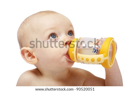 An adorbale little baby girl drinking from a colorful bottle with a teat - stock photo