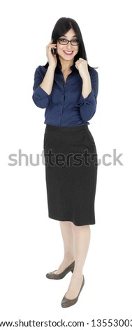 An adult (early 30's) black haired caucasian woman, looking extremely excited and happy while talking on the phone. She's hearing some good news. Isolated on white background. - stock photo