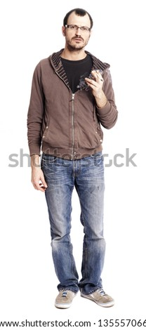 An adult man at his early 30's holding a rolled cigarette/joint in his hand. He's looking at the camera with a serious gaze, as if in the middle of speaking. Isolated on white background. - stock photo