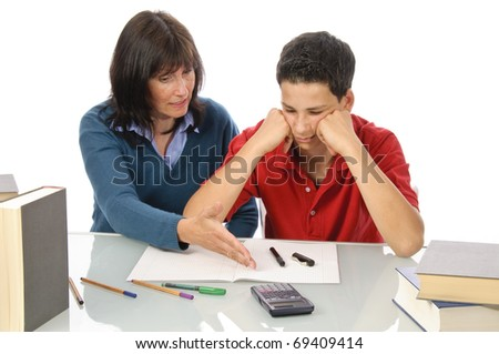 An adult woman, mother helps her son at the desk to make the homework, make the test, isolated against a white background.