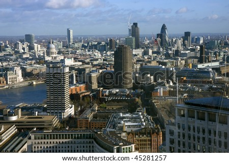 An aerial of London showing St Paul's Cathedral the Natwest Tower the Gherkin and the River Thames