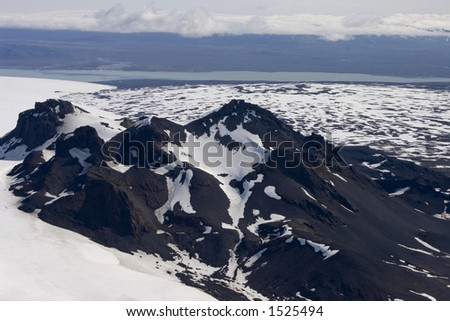 An aerial shot of volcanic mountains in Iceland