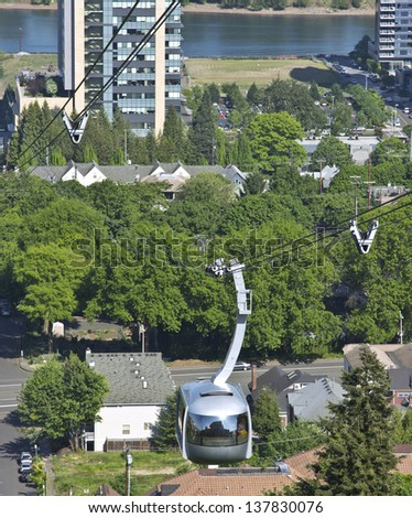 An aerial tram transporting people to and from the hilltop in Portland Oregon. - stock photo