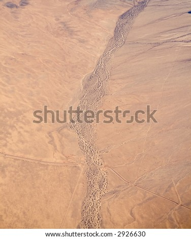 An aerial view of a dried riverbed in the California Mojave Desert - stock photo