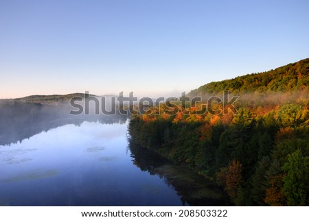 An aerial view of a hot air balloon floating over the Vermont country side   - stock photo