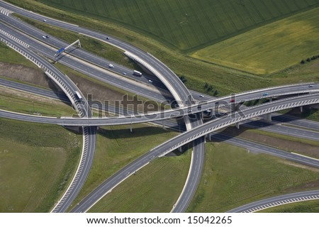 An aerial view of a motorway junction and flyover. - stock photo
