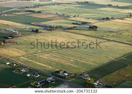 An aerial view of a patchwork of farm fields  - stock photo