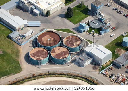 An aerial view of a sewage treatment facility - stock photo