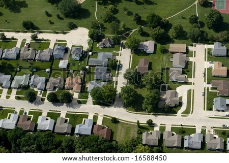 An aerial view of a suburban landscape. - stock photo