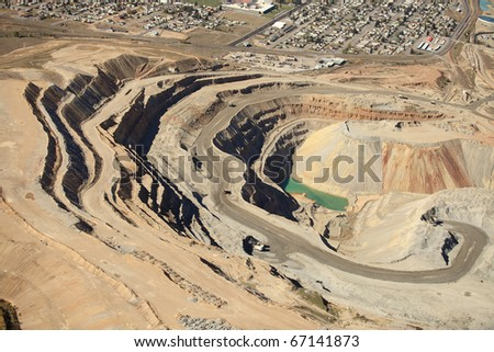 An aerial view of an open pit copper mine. - stock photo