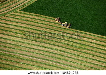 An aerial view of hay being harvested - stock photo