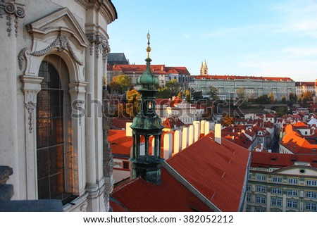 An aerial view of prague castle and malostranske namesti taken from the top of the saint nicolas church in prague.