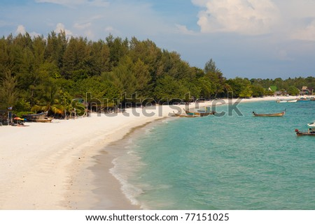 An aerial view of the gorgeous white sand beach and blue turquoise water of paradise island, Koh Lipe (aka Ko Lipeh), Thailand. - stock photo