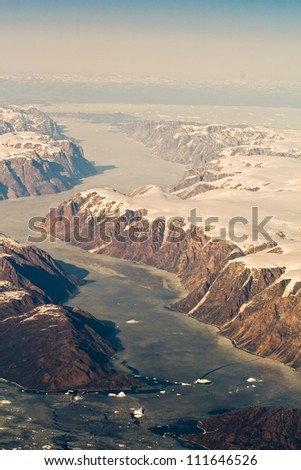 An aerial view of the mountains and fjords of Greenland. - stock photo