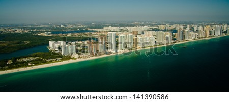 An aerial view of the seashore in Miami with deep green and blue waters. - stock photo