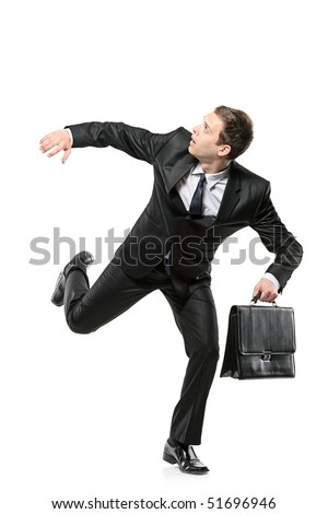 An afraid businessman running away isolated on white background - stock photo