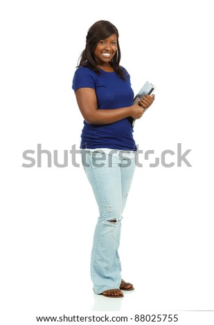 An African American College student smiling holding school supplies - stock photo