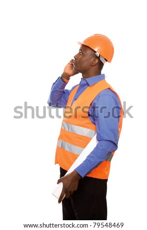 An african american foreman talking on the phone, isolated on white, side-view - stock photo