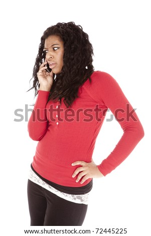 An African American is mad talking on the cell phone. - stock photo