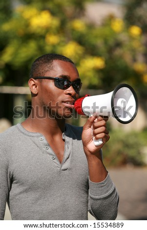an african american male model uses a megaphone to get his message heard loud and clear