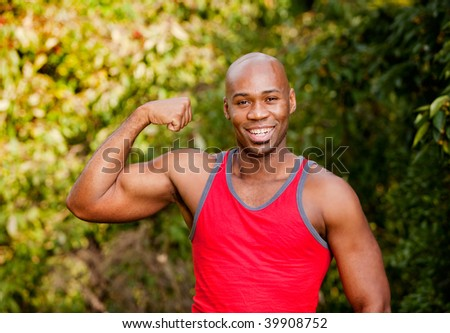 An African American man flexing his Bicep - stock photo