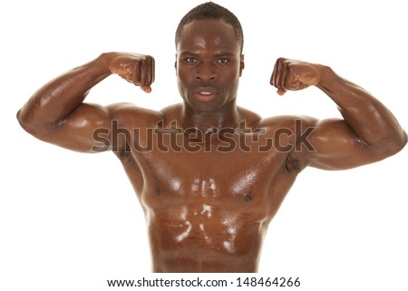 An African American man shirtless flexing his muscles.