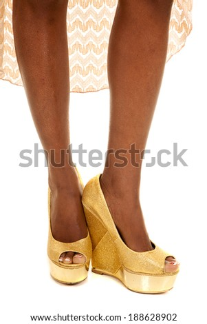 An African American showing off her legs in her heels. - stock photo