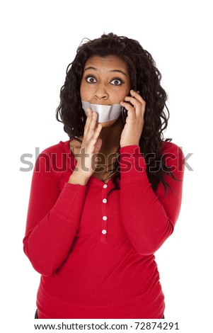 An African American woman has tape on her mouth. - stock photo