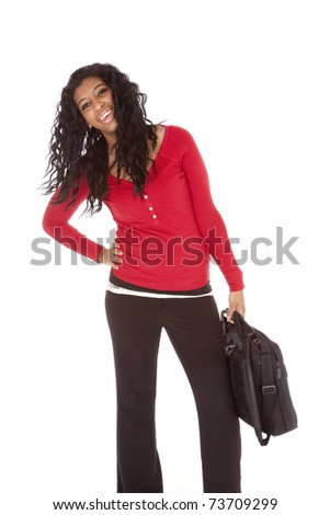 An African American woman is holding a bag. - stock photo