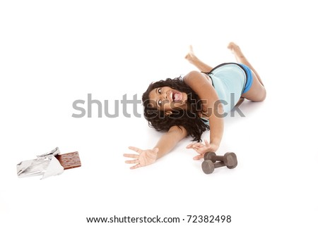 An African American woman is reaching for some chocolate. - stock photo
