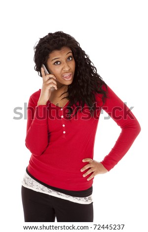 An African American woman with a funny expression is on the phone. - stock photo