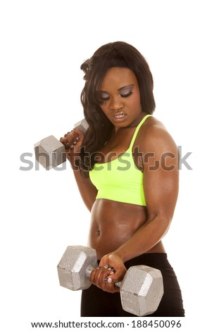 an African American working out with weights. - stock photo