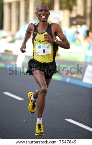 An African athlete about to finish the Singapore Marathon 2007 - stock photo