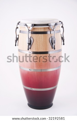 An African conga drum isolated against a white background in the vertical format with copy space. - stock photo