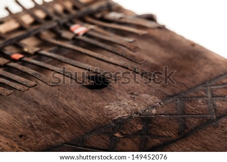 an african instrument named Mbira,  that consists of a wooden board with attached staggered metal keys - stock photo